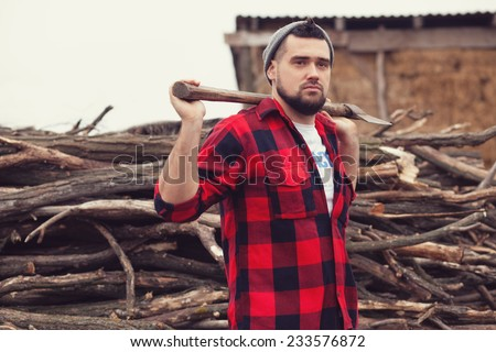 Stylish young man posing like lumberjack - stock photo