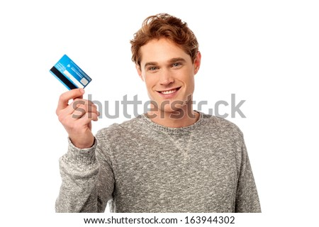 Stylish young man showing his cash card