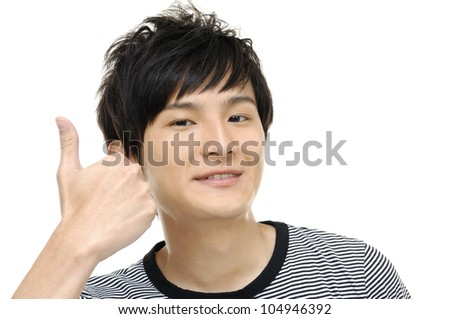 stylish young man standing showing thumbs up by both hands - stock photo