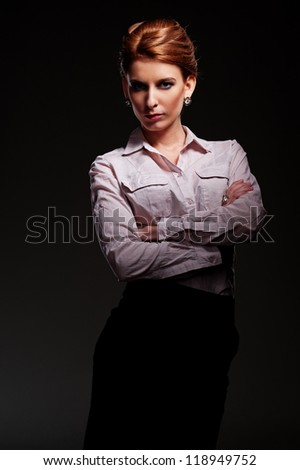 stylish young model in shirt over black background - stock photo