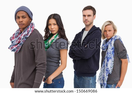 Stylish young people in a row on white background - stock photo