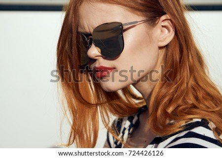 stylish, young woman in sunglasses portrait
