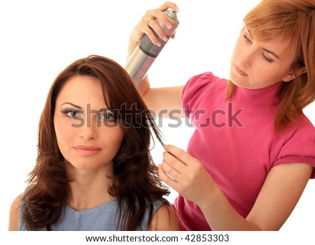 Stylist makes hair beautiful girl. - stock photo
