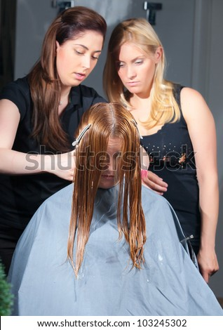 stylist training young specialist of work withclient in salon