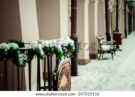 Stylized brown photo of the city bench in winter. Zamosc, Poland - stock photo