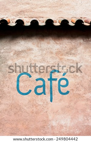 Stylized cafe sign on stone wall background in Prague. Outdoors. - stock photo