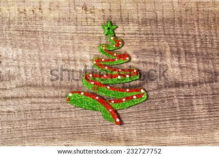 Stylized Christmas tree on wood background - stock photo