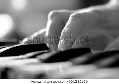 Stylized hand of pianist  in motion close-up in black and white