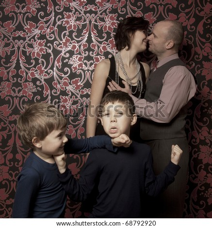 Stylized portrait of young happy family - stock photo