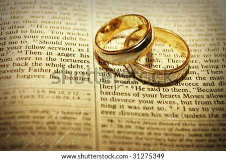 Stylized Wedding Rings on a Bible - stock photo