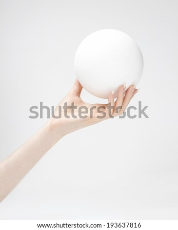 Styrofoam ball in hand - stock photo