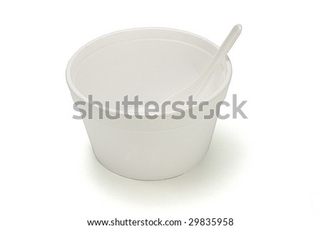 Styrofoam bowl and plastic spoon on white background - stock photo