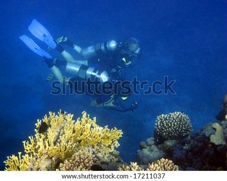 sub exploring the coral reef - stock photo