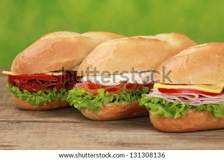 Sub Sandwiches with pepperoni, ham, salmon, cheese, tomatoes and lettuce