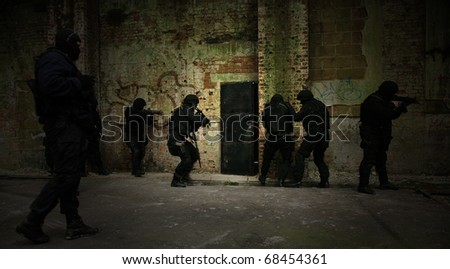 Subdivision anti-terrorist police during a black tactical exercises. Entry to the premises. Real situaion. - stock photo