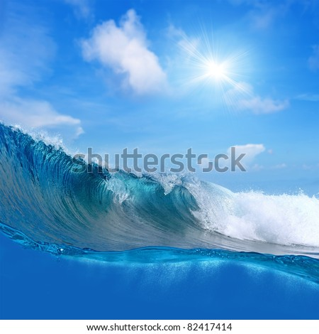 Submerged image breaking surfing ocean foamy wave cloudy sky the sun