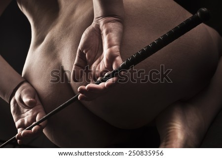 submissive girl waiting for punishment / spanking / bdsm theme
