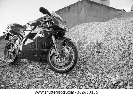 Subotica, Serbia: February 20th, 2016. Closeup of beautiful red Ducati 996s motorbike, photographed outdoor on a nice sunny day.Black and white photo. - stock photo