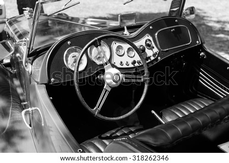 Subotica, Serbia - July 5, 2015: A DSLR photo of MG TC from 1947 interior on Public  Annual oldtimer car show Subotica 2015. Red body, roadster with roof down. Black and white photo. - stock photo