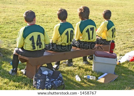 substitutes bench at local soccer game - stock photo