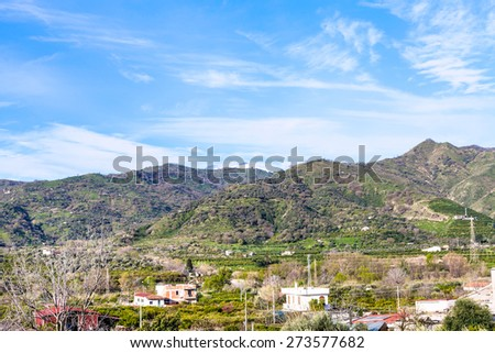 suburb of town Gaggi in green hills, Sicily, Italy in spring - stock photo