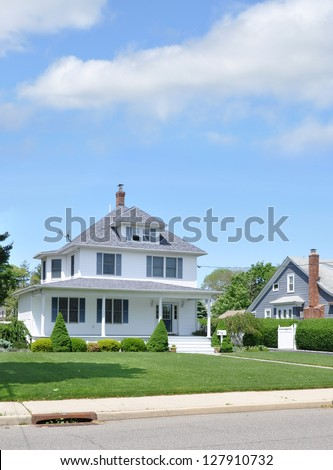Suburban American Square House Landscaped Sunny Blue Sky Day - stock photo