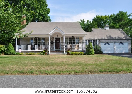 Suburban Bungalow Style Home with Attached Garage Residential neighborhood usa blue sky clouds - stock photo