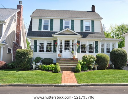Suburban Colonial Home Front Yard Landscaped Cottage Style Sunny - stock photo