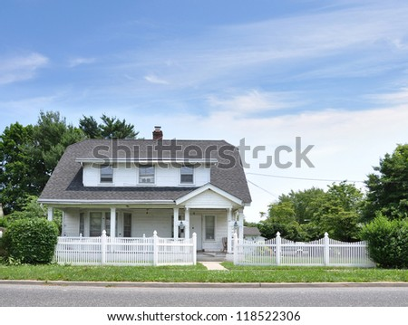 Suburban Cottage Home with White Picket Fence - stock photo