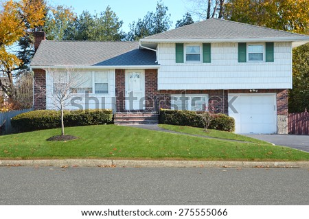 Suburban High Ranch Home at Twilight autumn day residential neighborhood USA
