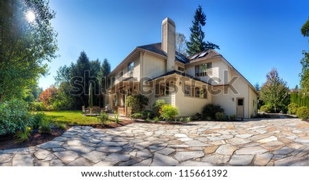 Suburban home and back garden on a sunny fall afternoon - stock photo