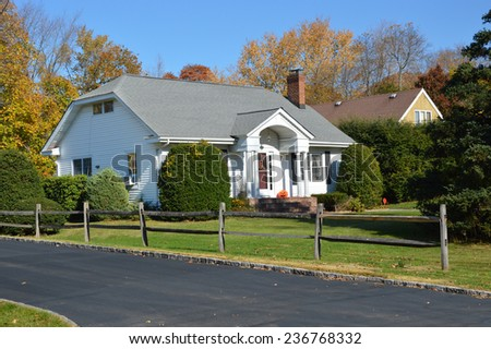 Suburban home autumn day residential neighborhood blue sky USA - stock photo