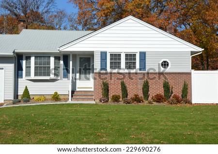 suburban home fall day residential neighborhood USA Blue Sky - stock photo
