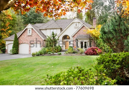 Suburban home in early Autumn as the leaves begin to turn - stock photo