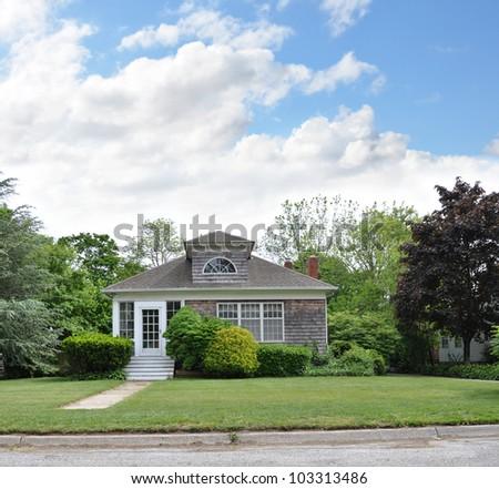 Suburban Home residential neighborhood cloudy blue sky - stock photo