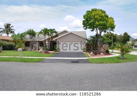 Suburban Home Snout Style Back Split architecture Palm Trees Blue Sky Clouds Day - stock photo