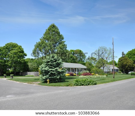 Suburban Home street corner residential neighborhood blue daytime sky - stock photo