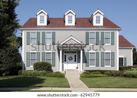 Suburban home with green shutters and red roof
