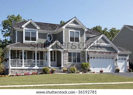 Suburban home with wraparound porch and columns