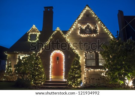 Suburban house decorated with lights for Christmas - stock photo