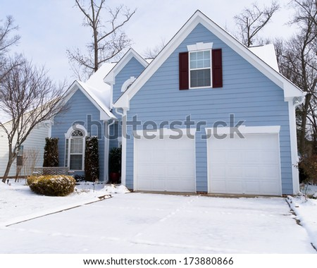 Suburban house in winter - stock photo