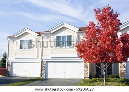 Suburban life - houses seen during the fall. - stock photo