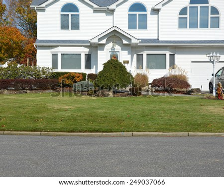 Suburban mcmansion close up view autumn day residential neighborhood USA - stock photo