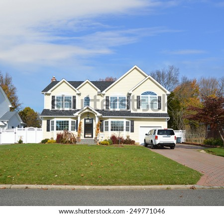 Suburban McMansion home autumn day blue sky residential neighborhood USA - stock photo