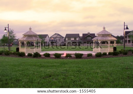 Suburban park with row houses in background - stock photo