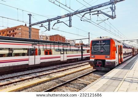 Suburban railway train at the railways stantion . - stock photo