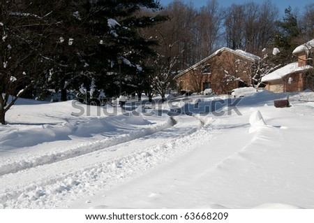Suburban Street Covered in Fresh Deep Snow on a Sunny Winter Day - stock photo