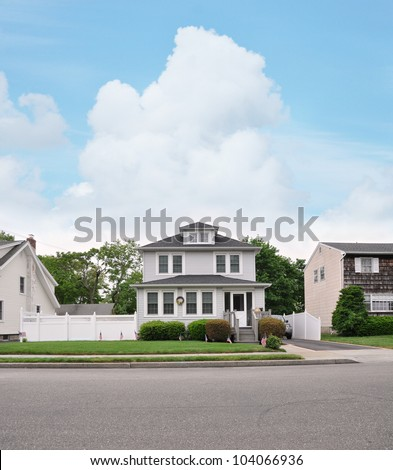 Suburban Two Story Home with American Flags Residential Neighborhood Street - stock photo