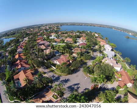 Suburban waterfront neighborhood in Florida seen in aerial view - stock photo