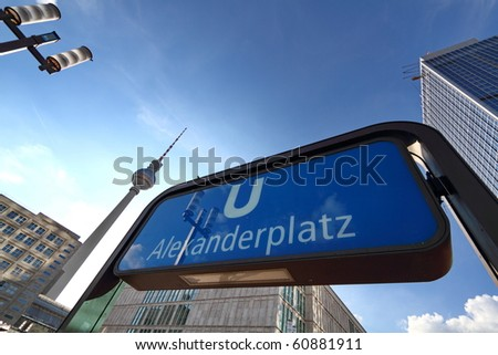 Subway Entrance on the famous Alexanderplatz in Berlin with TV Tower in the Background - stock photo